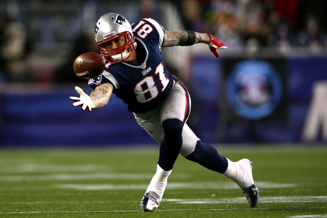 Aaron Hernandez #81 of the New England Patriots misses a catch against the Baltimore Ravens during the 2013 AFC Championship game at Gillette Stadium on January 20, 2013 in Foxboro, Massachusetts.