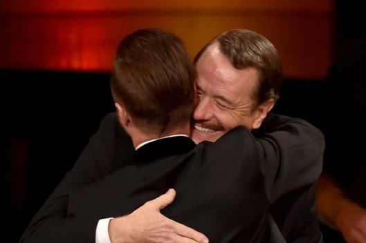 LOS ANGELES, CA - AUGUST 25:  Actor Bryan Cranston (R) celebrates winning Outstanding Lead Actor in a Drama Series for 'Breaking Bad' with co-star Aaron Paul at the 66th Annual Primetime Emmy Awards held at Nokia Theatre L.A. Live on August 25, 2014 in Los Angeles, California.  (Photo by Kevin Winter/Getty Images)