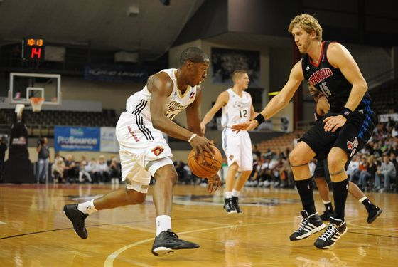 ERIE, PA - NOVEMBER 20:  Tasmin Mitchell #14 of the Erie Bayhawks looks to move the ball against Mike Williams #15 of the Springfield Armor during a NBA D-League game on November 20, 2010 at the Tullio Arena in Erie, Pennsylvania.  NOTE TO USER: User expressly acknowledges and agrees that, by downloading and or using this photograph, User is consenting to the terms and conditions of the Getty Images Liscense Agreement.  Mandatory Copyright Notice: Copyright 2010 NBAE (Photo by Robert Frank/NBAE via Getty Images) *** Local Caption *** Mike Williams;Tasmin Mitchell