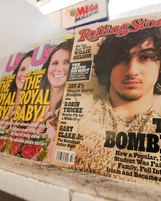 July 17, 2013 - Orange County, California, USA - The August 1, 2013 issue of Rolling Stone Magazine features on the cover a portrait of alleged Boston Bombing suspect Jahar Tsarnaev. The controversial cover, with a 12 page article attributed to Rolling Stone Contributing Editor Janet Reitman, has many in Boston upset at what many have come to expect to be on the cover of the Rolling Stone, a rock star, adding that the photo resembles a September 1981Rolling Stone Cover of the late Jim Morrison.---In the photo a copy of Rolling Stone with the controversial cover on display with other magazines at an Orange County. California Liquor Store. (Credit Image: ? David Bro/ZUMAPRESS.com)