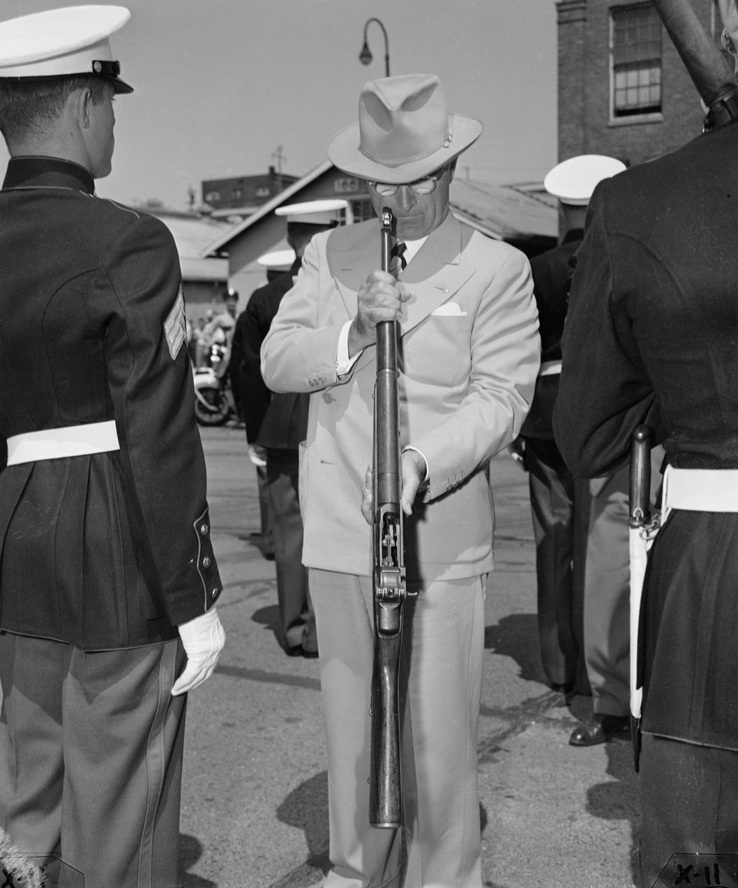 09 Jun 1948, Bremerton, Washington State, USA --- Original caption: June 9, 1948 - Bremerton, Washington: President Truman looks into the barrel of a Grand rifle during an inspection of Marine troops in Bremerton, Washington, before proceeding to Seattle, June 10, 1948 on his cross country tour. Speaking in a Seattle stadium that was about half full, the Chief Executive again charged that the Republican controlled congress has prevented passage of important legislation. --- Image by ? Bettmann/CORBIS