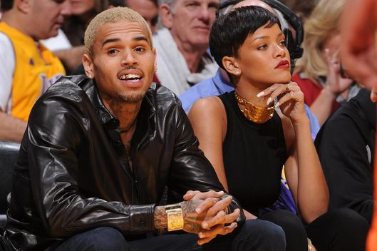 Recording artists Chris Brown and Rihanna attend a game between the New York Knicks and the Los Angeles Lakers at Staples Center on December 25, 2012 in Los Angeles, California.