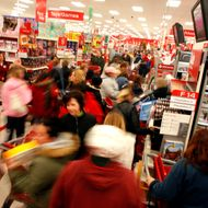 PLEASANT PRAIRIE, WI - NOVEMBER 28:  Holiday shoppers race around for gifts after braving the cold temperatures out side of Target as they start the traditional holiday shopping season November 28, 2008 in Pleasant Prairie, Wisconsin. The day after Thanksgiving is typically the busiest shopping day of the year and traditionally a indicator of the economy and how the holiday shopping season will go. (Photo by Darren Hauck/Getty Images)