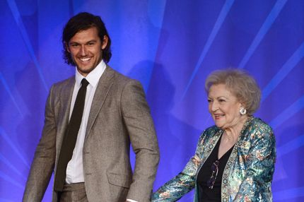LOS ANGELES, CA - APRIL 20:  Actors Alex Pettyfer (L) and Betty White speak onstage at the 24th Annual GLAAD Media Awards presented by Ketel One and Wells Fargo at JW Marriott Los Angeles at L.A. LIVE on April 20, 2013 in Los Angeles, California.  (Photo by Kevin Winter/Getty Images for GLAAD)