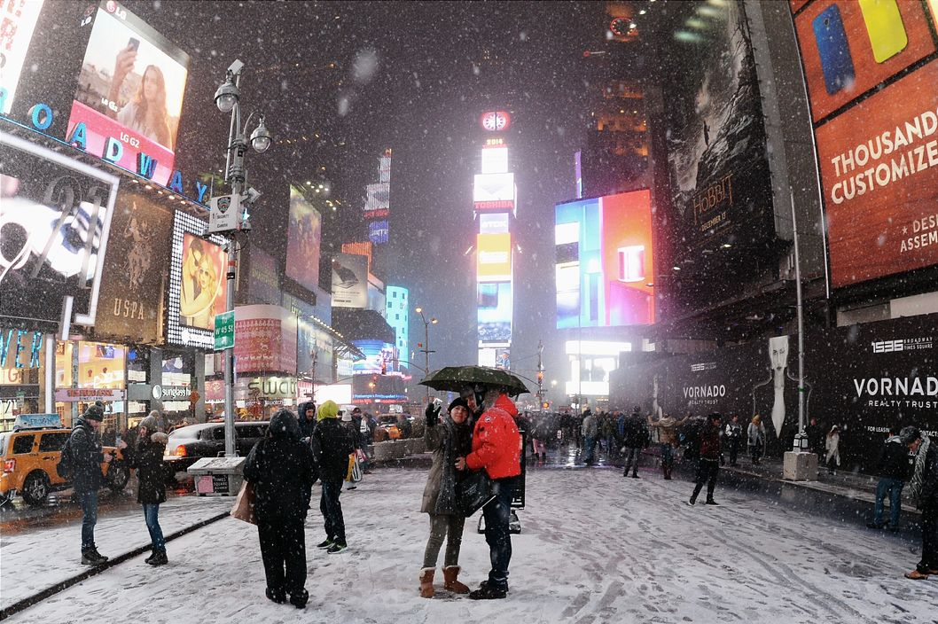 Tourists enjoy the snow in Times Square on January 2, 2014.
