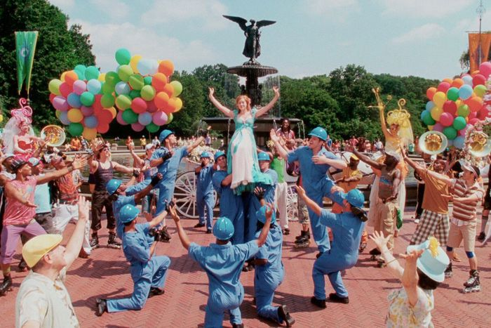A still of a group dance number from the NYC-set Disney movie