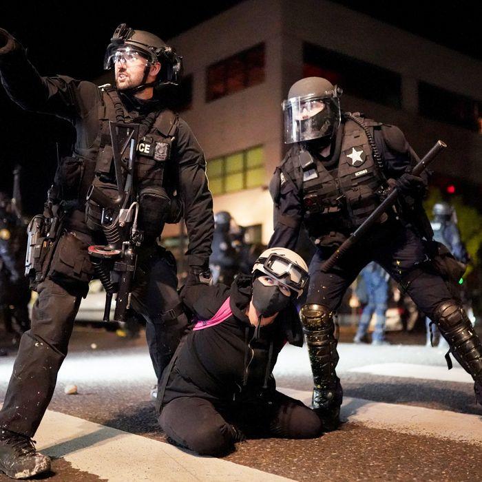 Officers arresting a protester.