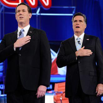 MESA, AZ - FEBRUARY 22: Republican presidential candidates former U.S. Sen. Rick Santorum (L) and former Massachusetts Gov. Mitt Romney sing the national anthem at a debate sponsored by CNN and the Republican Party of Arizona at the Mesa Arts Center February 22, 2012 in Mesa, Arizona. The debate is the last one scheduled before voters head to the polls in Michigan and Arizona's primaries on February 28 and Super Tuesday on March 6. (Photo by Ethan Miller/Getty Images)
