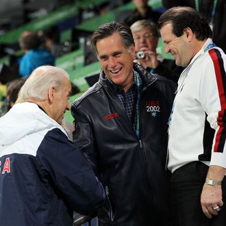 United States vice-president Joe Biden talks with former govenor Mitt Romeny and Mike Eruzione attend women's ice hockey preliminary game between United States and China at UBC Thunderbird Arena on February 14, 2010 in Vancouver, Canada.