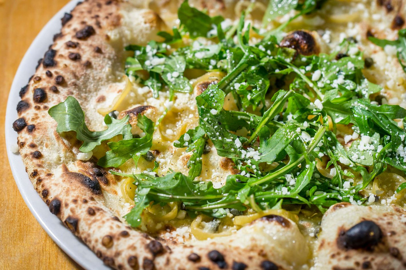 Salty, Hot and Bitter Love: wax peppers, fontina, capers, arugula, Pecorino Romano.