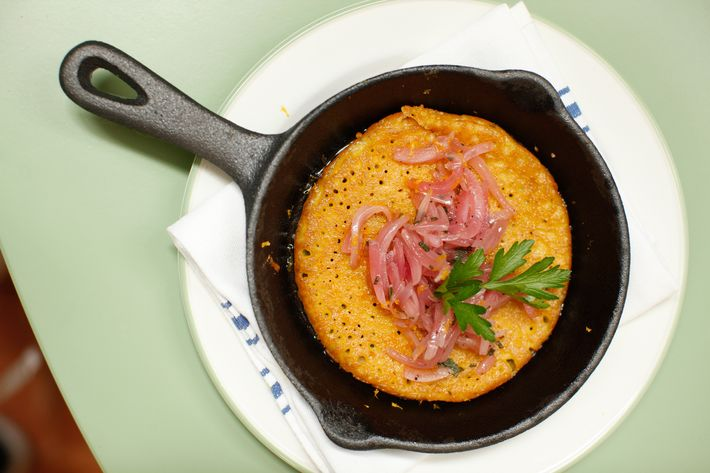 Farinata: a traditional savory pancake from Liguria. It's made from chickpea flour and topped with red onion.