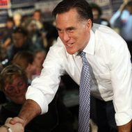 FAIRFAX, VA - OCTOBER 26: Republican presidential candidate and former Massachusetts Gov. Mitt Romney shakes hands at the headquarters of the Fairfax County Republican Committee October 26, 2011 in Fairfax, Virginia. Romney campaigned with Virginia Gov. Bob McDonnell and thanked phone bank volunteers for their efforts in an upcoming state election. (Photo by Win McNamee/Getty Images)