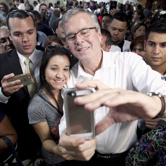 Former Florida Governor and probable 2016 Republican presidential candidate Jeb Bush poses for a selfie during a town hall meeting in San Juan