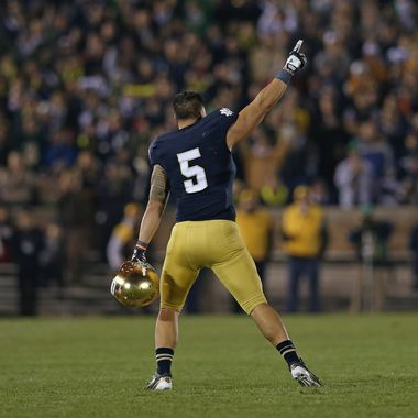 Manti T'eo #5 of the Notre Dame Fighting Irish waves to the crowd as he leaves the home field for the last time during a game against the Wake Forest Demon Deacons at Notre Dame Stadium on November 17, 2012 in South Bend, Indiana. Notre Dame defeated Wake Forest 38-0.