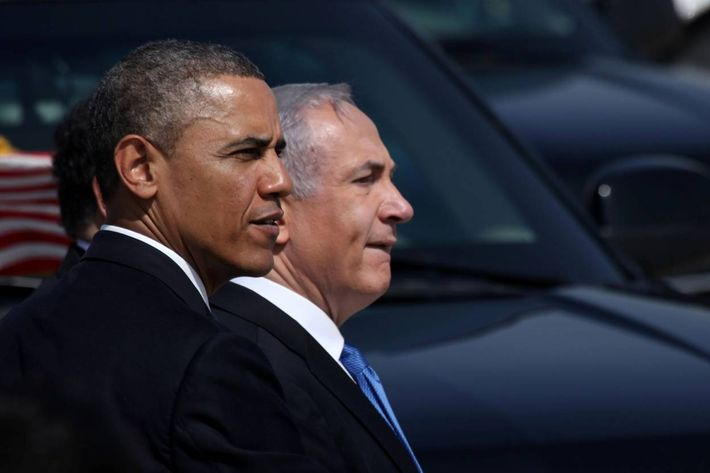 TEL AVIV, ISRAEL - MARCH 20: U.S. President Barack Obama (L) is greeted by Israeli Prime Minister Benjamin Netanyahu during an official welcoming ceremony on his arrival at Ben Gurion International Airport on March, 20, 2013 near Tel Aviv, Israel. This will be Obama's first visit as president to the region, and his itinerary will include meetings with the Palestinian and Israeli leaders as well as a visit to the Church of the Nativity in Bethlehem.  (Photo by Marc Israel Sellem-Pool/Getty Images)