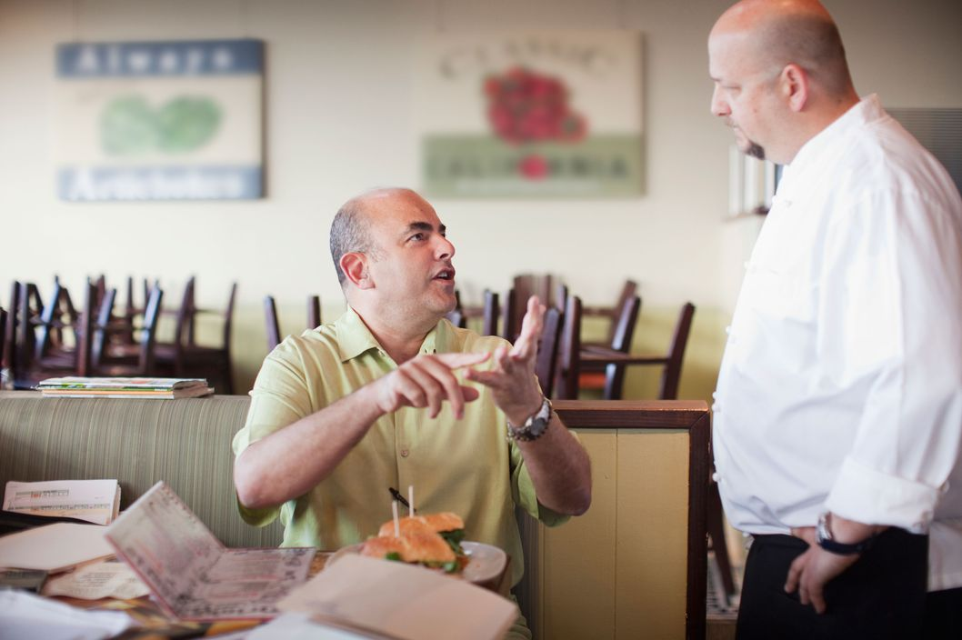 Los Angeles, California, USA --- Angry customer complaining to chef in restaurant --- Image by ? Ronnie Kaufman/Larry Hirshowitz/Blend Images/Corbis