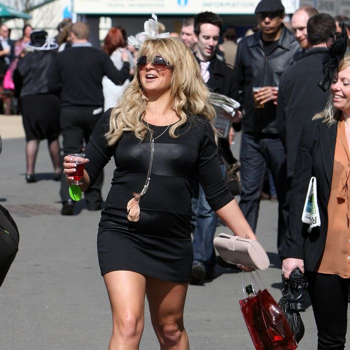 Racegoers at the 'Liverpool Day' at Aintree races as the Grand National meeting kicked off, UK
