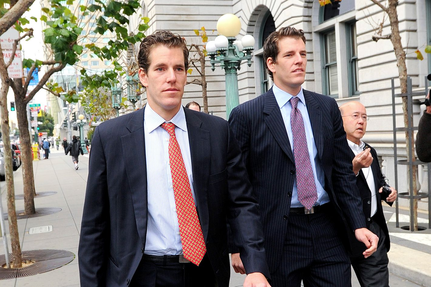 Cameron Winklevoss, left, and his twin brother Tyler leave a federal appeals court in San Francisco, California, U.S., on Tuesday, Jan. 11, 2011. Facebook Inc.'s settlement of claims that its founder Mark Zuckerberg stole the idea for what became the world's largest social-networking website should be undone, former college classmates of Zuckerberg told an appeals court. Photographer: Noah Berger/Bloomberg via Getty Images *** Local Caption *** Cameron Winklevoss; Tyler Winklevoss