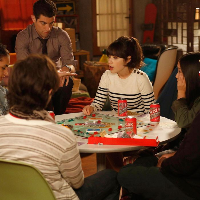 NEW GIRL: Jess (Zooey Deschanel, third from R) and Schmidt (Max Greenfield, third from L) hang out with their new neighbors (Guest stars: Charlie Saxton (R), Jinny Chung (second from R), Jasmine Di Angelo, second from L) in the