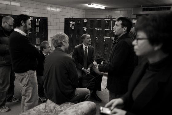 DES MOINES, IA - JANUARY 01: *** EXCLUSIVE *** Democratic Presidential hopeful Senator Barack Obama (D-IL) huddles with his senior campaign staff, including strategist David Axelrod, campaign manager David Plouffe, media adviser Jim Margolis, communications director Robert Gibbs and Iowa state director Paul Tewes in the school locker room after speaking to voters at a rally at Roosevelt High School January 1, 2008 in Des Moines, Iowa. Presidential candidates from the Democratic and Republican parties are currently campaigning throughout Iowa trying to win over voters before the Thursday caucus.  (Photo by Charles Ommanney/Getty Images)