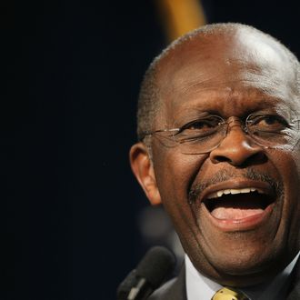 DES MOINES, IA - OCTOBER 22: Republican Presidential Candidate Herman Cain speaks to a gathering of conservative Christians at the Iowa Faith & Freedom Coalition Presidential Forum on October 22, 2011 in Des Moines, Iowa. Candidates Herman Cain, Michele Bachmann, Rick Perry, Newt Gingrich, Ron Paul, and Rick Santorum are scheduled to speak at the event, all hoping to gain support of the roughly 1000 in attendance in front of the January 3, 2012 Iowa caucus. (Photo by Scott Olson/Getty Images)