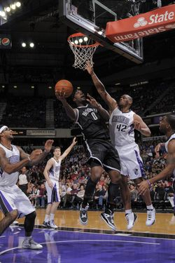 Andray Blatche #0 of the Brooklyn Nets shoots the ball against Chuck Hayes #42 of the Sacramento Kings on November 18, 2012 at Sleep Train Arena in Sacramento, California.