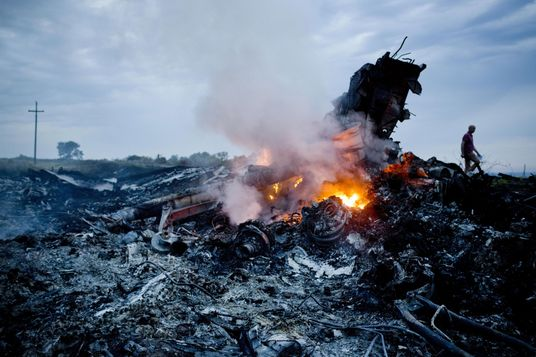 Debris from Malaysia Airlines Flight 370 is shown smouldering in a field  July 17, 2014 in Grabovo, Ukraine near the Russian border. Flight 370, on its way from Amsterdam to Kuala Lumpur and carrying 295 passengers and crew, is believed to have been shot down by a surface-to-air missile, according to U.S. intelligence officials Ukrainian authorities quoted in published reports. The area is under control of pro-Russian militias.