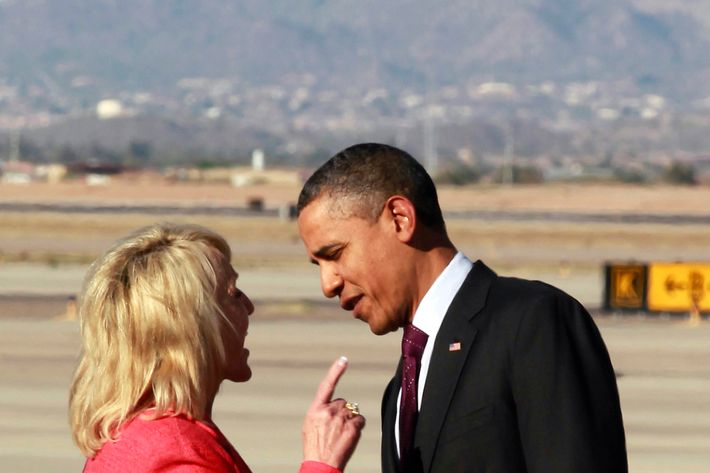 Arizona Gov. Jan Brewer points during an intense conversation with President Barack Obama after he arrived at Phoenix-Mesa Gateway Airport, Wednesday, Jan. 25, 2012, in Mesa, Ariz.