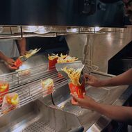 An employee serves French fries at a US fast food Mac Donalds restaurant on December 1, 2011 in Ramonville-Saint-Agne, a Toulouse suburb, southern France. AFP PHOTO REMY GABALDA (Photo credit should read REMY GABALDA/AFP/Getty Images)