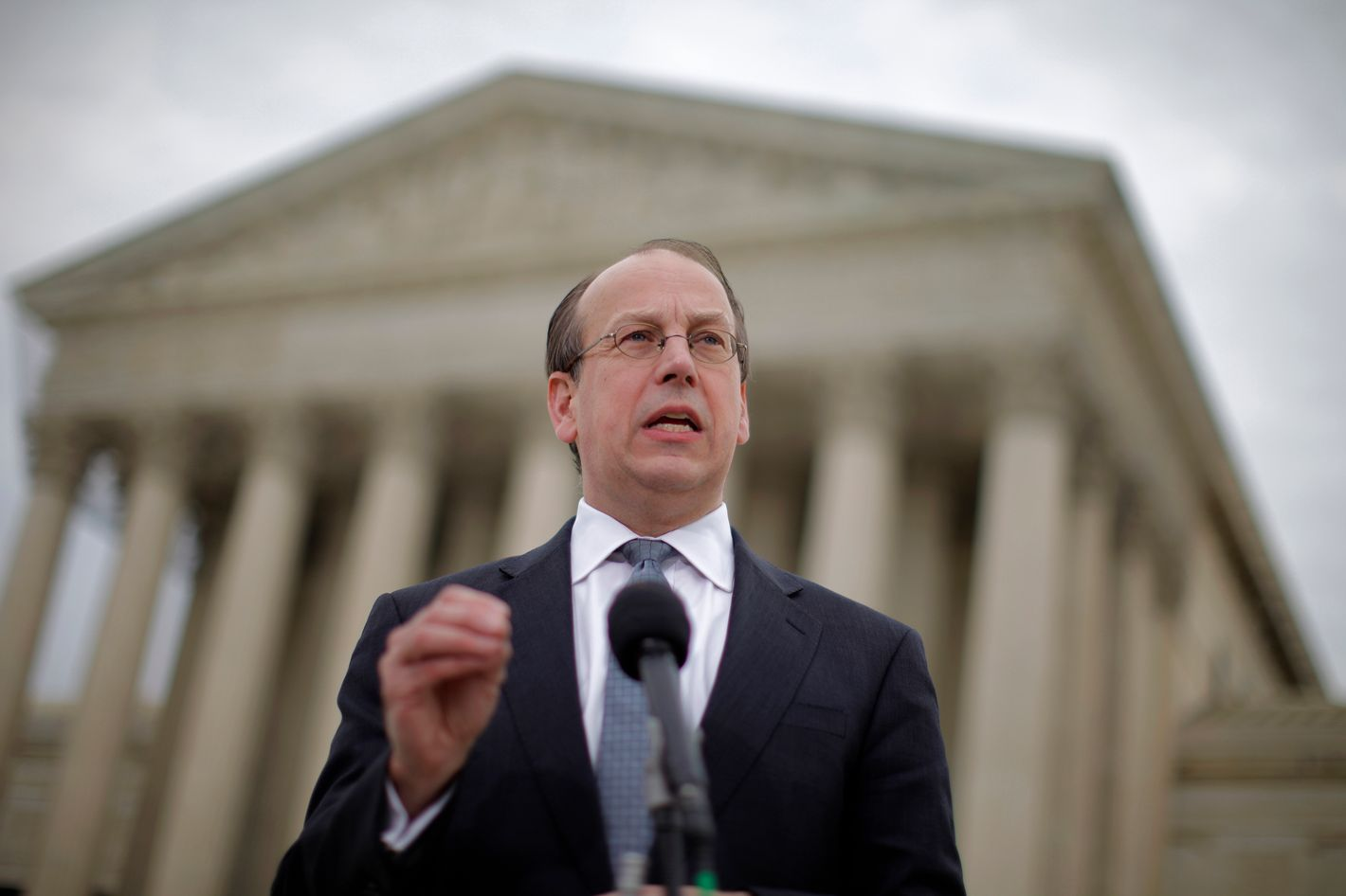 Paul Clement, a lawyer for 26 states seeking to have the Patient Protection and Affordable Care Act tossed out in its entirety, speaks to reporters in front of the Supreme Court in Washington, Wednesday, March 28, 2012, at the end of arguments regarding the health care law signed by President Barack Obama. (AP Photo/Charles Dharapak)