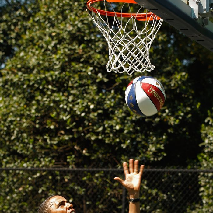 U.S. President Barack Obama shoots a basketball while participating in a