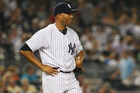 NEW YORK, NY - AUGUST 09:  Mariano Rivera #42 of the New York Yankees looks on after giving up a two run homerun in the top of the ninth inning to Bobby Abreu #53 of the Los Angeles Angels of Anaheim (not pictured) on August 09, 2011 at Yankee Stadium in the Bronx borough of New York City. Angels defeated the Yankees 6-4. (Photo by Mike Stobe/Getty Images)