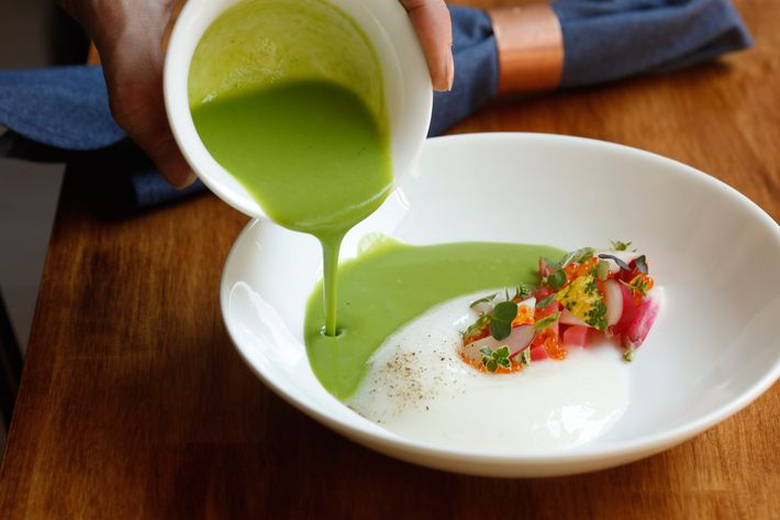 Radish-top gazpacho with smoked trout roe and lemon balm.