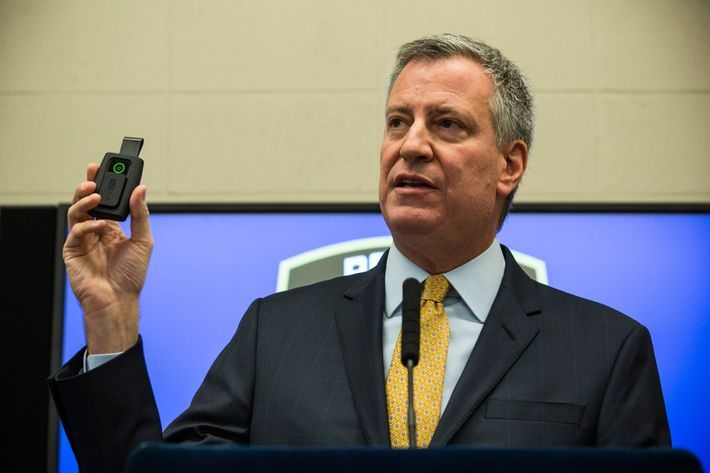 New York City Mayor Bill de Blasio holds up a body camera that the New York Police Department (NYPD) will begin using during a press conference on December 3, 2014 in New York City. The NYPD is beginning a trial exploring the use of body cameras; starting Friday NYPD officers in three different precincts will begin wearing body cameras during their patrols.