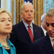 US Vice President Joe Biden (C), US Secretary of State Hillary Clinton (L) and White House Chief of Staff Rahm Emanuel (R) stand in the Oval Office of the White House while US President Barack Obama (not pictured) meets with President of Palestine Mahmoud Abbas (not pictured) May 28, 2009 in Washington DC.