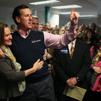 Republican presidential candidate, former U.S. Sen. Rick Santorum holds his wife Karen while speaking to supporters on January 14 in South Carolina.