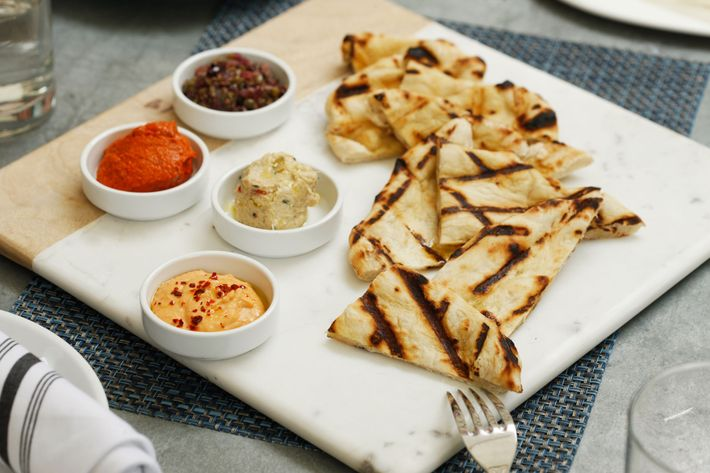 Grilled flatbread with dips.