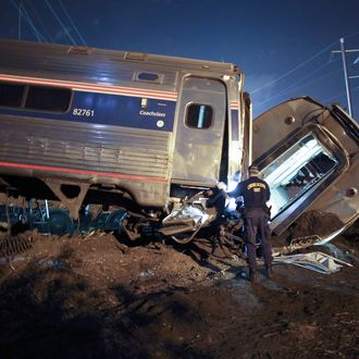 Emergency personnel work the scene of a deadly train wreck, Tuesday, May 12, 2015, in Philadelphia. An Amtrak train headed to New York City derailed and crashed in Philadelphia. (AP Photo/ Joseph Kaczmarek)