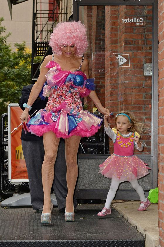 Nothing tops off a good costume like the inclusion of a small child, who may be wondering why her mom has one blue foil-covered boob.