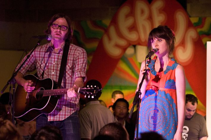 DENVER - AUGUST 27:  Ben Gibbard and Zooey Deschanel perform on the VIP stage at Unconventional '08 at the Manifest Hope Gallery on August 27, 2008 in Denver, Colorado.  (Photo by Timothy Norris/Getty Images)