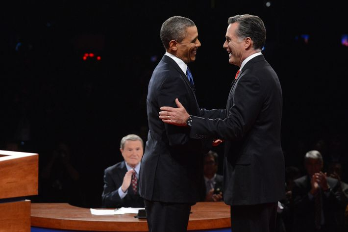 DENVER, CO - OCTOBER 03:  U.S. President Barack Obama (2nd L) and Republican presidential candidate and former Massachusetts Gov. Mitt Romney (R) greet each other during the Presidential Debate at the University of Denver as moderator Jim Lehrer looks on October 3, 2012 in Denver, Colorado. The first of four debates for the 2012 Election, three Presidential and one Vice Presidential, is moderated by PBS's Jim Lehrer and focuses on domestic issues:  the economy, health care, and the role of government.  (Photo by Michael Reynolds-Pool/Getty Images)
