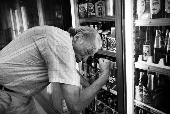 Decisions, decisions: Bukowski brandishes his guns while grabbing a six-pack.