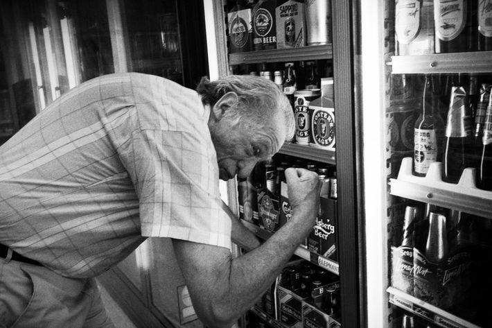 Decisions, decisions: Bukowski brandishes his guns while grabbing a six-pack.