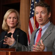 U.S. Sen. Rand Paul (R-KY) speaks while U.S. Sen. Kirsten Gillibrand (D-NY) listens during a news conference on sexual assault in the military, July 16, 2013 in Washington, DC. U.S. Sen. Gillibrand announced the support of 34 senators that will co-sponsor her proposal to take the decision whether to prosecute sexual assaults out of the hands of the military chain of command. (Photo by Mark Wilson/Getty Images)
