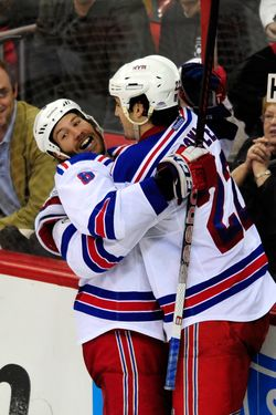 RALEIGH, NC - MARCH 01:  Brandon Prust #8 and Brian Boyle #22 of the New York Rangers celebrate Prust's game-winning goal against the Carolina Hurricanes during play at the RBC Center on March 1, 2012 in Raleigh, North Carolina. Boyle assisted on the goal as the Rangers won 3-2.  (Photo by Grant Halverson/Getty Images)