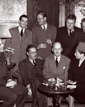 Fritz Foord, Wolcott Gibbs, Frank Case and Dorothy Parker (seated left to right) and Alan Campbell, St. Clair McKelway, Russell Maloney and James Thurber (standing left to right) at a cocktail party at the Hotel Algonquin held to celebrate the success of Case's book