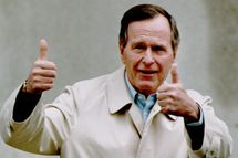 "U.S. President George Bush responds to reporters 12 January 1993 as he leaves Bethesda Naval Hospital, Bethesda, MD after his annual physical examination. ""Clean bill of health,"" Bush said."