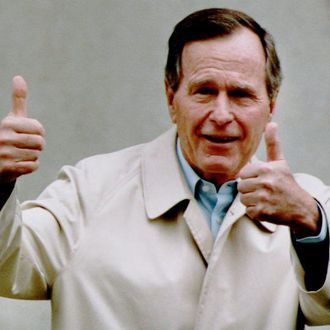U.S. President George Bush responds to reporters 12 January 1993 as he leaves Bethesda Naval Hospital, Bethesda, MD after his annual physical examination.