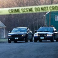 NEWTOWN, CT - DECEMBER 15:  Newtown police officers watch over the blocked off section of Yogananda Street on Saturday morning, where the the mother of Adam Lanza, the alleged shooter, was killed at her home on Friday in Newtown, Connecticut. Twenty six people were shot dead, including twenty children, after a gunman identified as Adam Lanza opened fire at Sandy Hook Elementary School. Lanza also reportedly had committed suicide at the scene. A 28th person, believed to be Nancy Lanza was found dead in a house in town, was also believed to have been shot by Adam Lanza.  (Photo by Jared Wickerham/Getty Images)