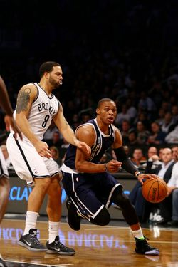 Russell Westbrook #0 of the Oklahoma City Thunder drives past Deron Williams #8 of the Brooklyn Nets during their game at the Barclays Center on December 4, 2012 in the Brooklyn borough of New York City.